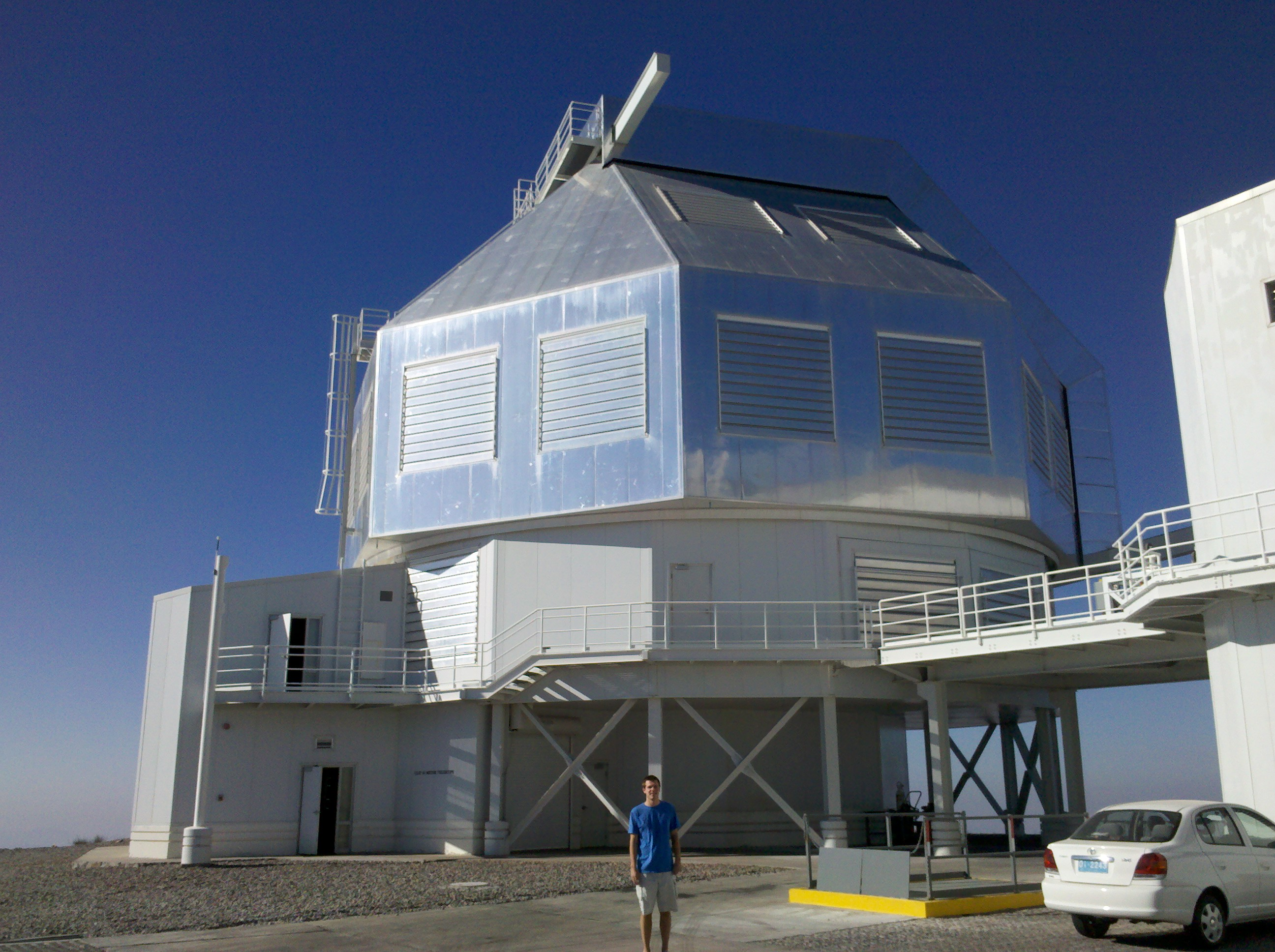Ian in front of the Clay 6.5 meter telescope at Las Campanas Observatory in Chile.