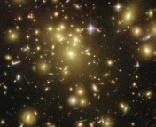 The rich cluster Abell 1689. Abell found it first, so he got to name it. Note the gravitationally-lensed images of galaxies (the light blue streaks), indicating a high concentration of mass. Image from the Hubble Space Telescope.