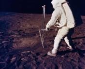 Astronaut Buzz Aldrin takes a core sample of the Moon. Image copyright NASA.