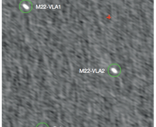 The Serendipitous Discovery of Two Stellar Mass Black Holes in the Globular Cluster M22