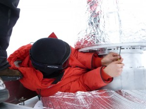 Attaching the forebaffle to the telescope