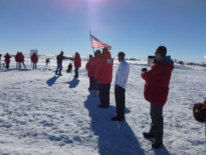 Passing the flag during the pole moving ceremony