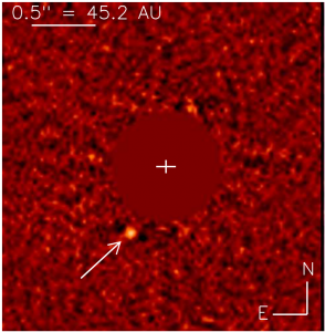 Figure 1 - Image of the newly discovered planet, HD 95086 b.  The star has been blocked out by a coronagraph and the diffraction patterns removed during data reduction.