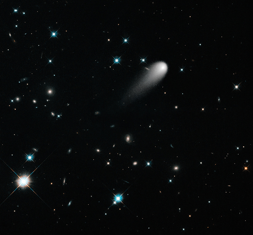 Fig 1: Composite image from the Hubble Space Telescope showing Comet ISON against a background of stars and galaxies.