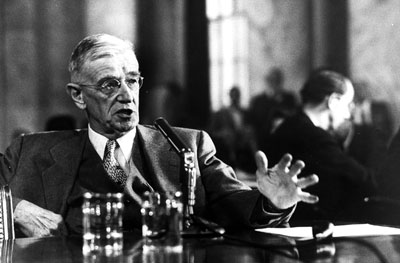 Vannevar Bush looks very important with a suit, microphone, and not one, but two, glasses of water. (Pielke 2010, Nature)