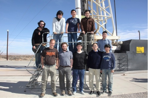 Anson (top center) and the CIBER group in front of our rocket at the White Sands Missile Range.