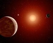 Artist's illustration of planets orbiting an M-dwarf star (NASA/JPL-Caltech).