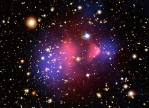 Fig. 1 - An image of the Bullet Cluster, showing galaxies, hot cluster gas (red), and total mass from gravitational lensing (purple). The strong detection of additional mass from lensing is a major indicator of dark matter. Image C/O NASA/CXC/STScI