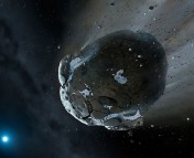 This is an artist's impression of a rocky and water-rich asteroid being torn apart by the strong gravity of the white dwarf star GD 61. Similar objects in our solar system likely delivered the bulk of water on Earth and represent the building blocks of the terrestrial planets.