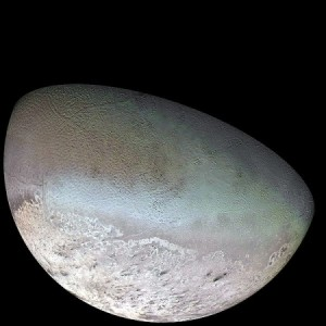 An image of Triton, a moon of Neptune taken by Voyager 2. The surface features of Pluto are expected to be similar to those captured on Triton.