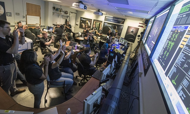 NASA's New Horizon's Team celebrates at Mission Control on Tuesday 13th July when the signal from the probe was received at precisely 8.52.37pm ET. Photograph: Bill Ingalls/AP