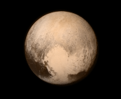 Pluto, as imaged by the LORRI instrument on board New Horizons just hours before it's closet approach. Image from NASA.