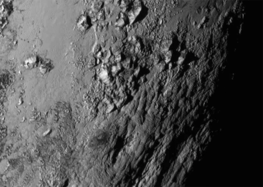 Mountains on Pluto's surface are imaged by the LORRI instrument 1.5 hours before New Horizon's closest approach when it was 770,000 km above the surface. Image from NASA.