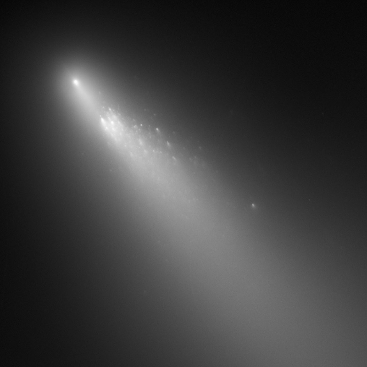 Disintegration of a comet in our Solar System caught by the eye of the Hubble Space Telescope. This comet, named 73P/Schwassmann-Wachmann 3, fragmented off many pieces as it plummeted toward the Sun in 2006. As the radiation from a star heats a comet, the ices that hold it together sublimate, releasing large chunks of rock into space. Something similar may be happening near KIC 8462852.