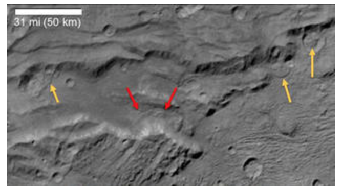 Landslides on Charon, discovered by New Horizons. Image credit: NASA/JHUAPL/SwRI