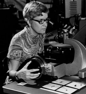 "Vera Rubin using her ""measuring machine"" to analyze photographic plates. Courtesy of the Carnegie Institution of Washington."