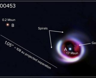 Imaged Companion Drives Spiral Arms in Disk