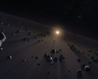 Our Solar System: Another Planet or Another Disk?