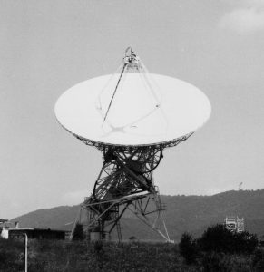 Howard  E Tatel telescope in black and white during the daytime, pointed at the sky