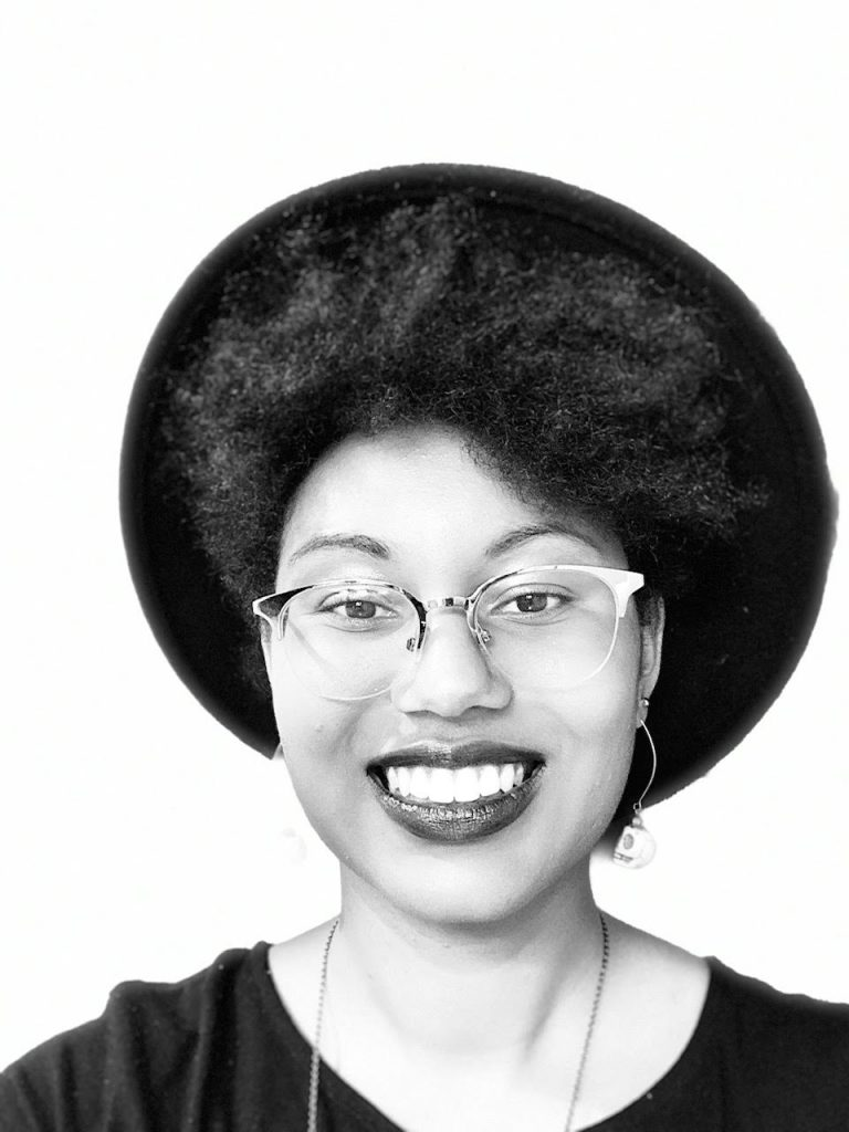 Profile picture of Bryné Hadnott, a Black female planetary scientist and science educator being featured in today's profile