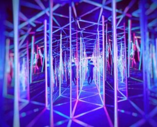 An Extreme, Distant Quasar in the Cosmic House of Mirrors