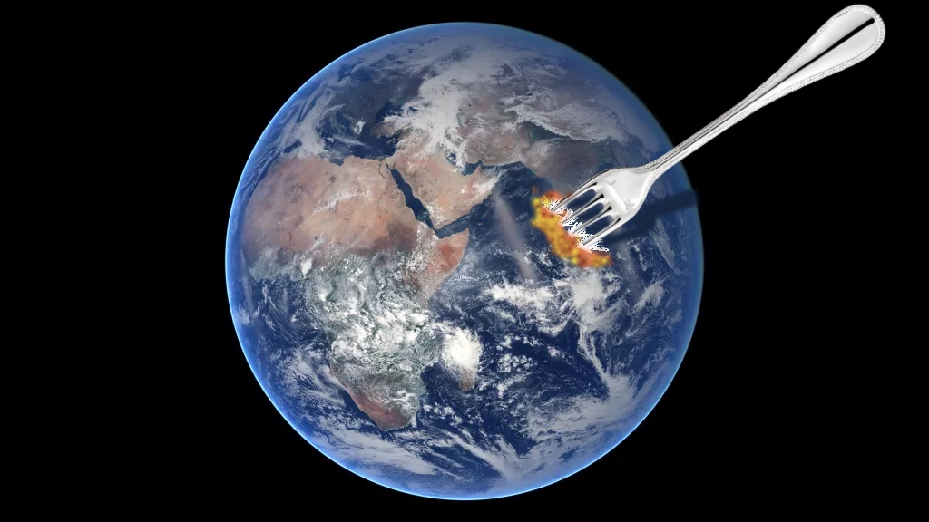 Earth with fork sticking out of it.